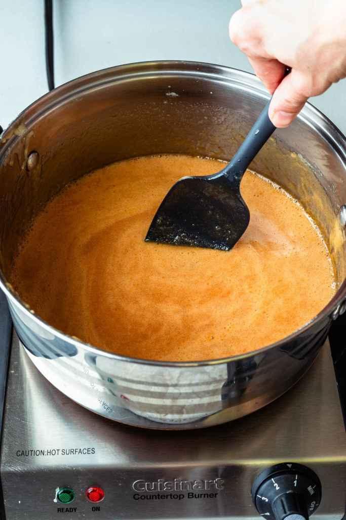 boiling sugar and milk in a saucepan.