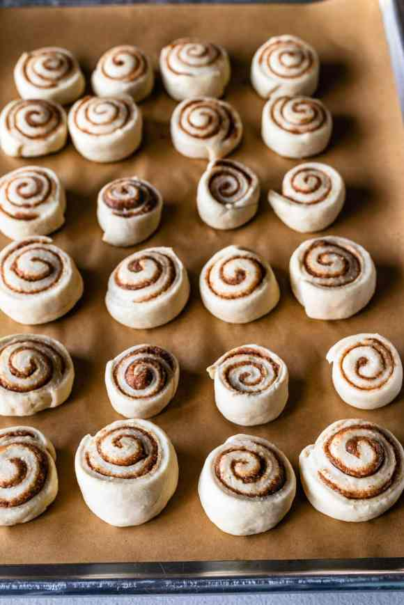 tray with unbaked cinnamon rolls on top.