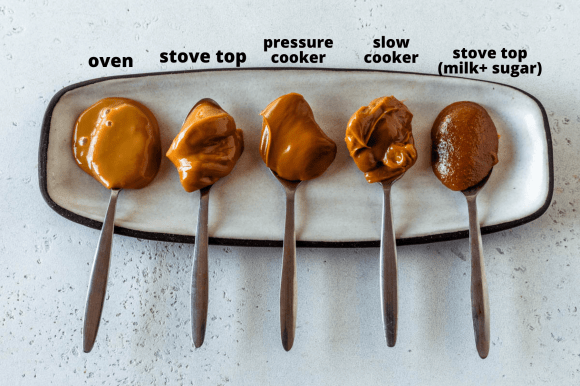 5 spoons with dulce de leche made with different methods on a plate.