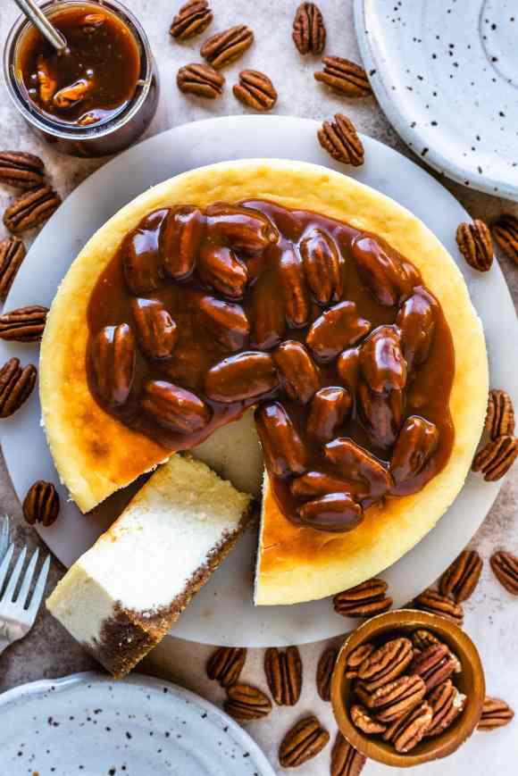 cheesecake seen from the top, topped with pecan caramel sauce.