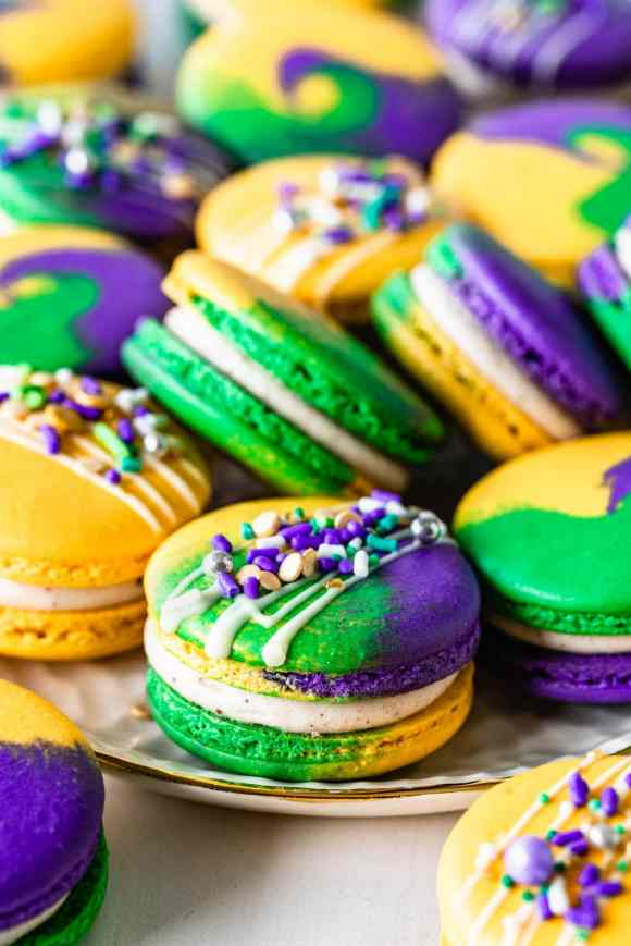purple, green and yellow macarons topped with sprinkles for mardi gras.