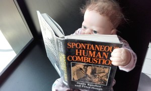 Baby reads book