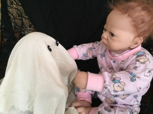 Baby with creepy doll ghost