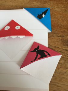 Book page markers with a monster a demon and a dwarf