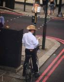 I don't care why this guy is wearing a cocktail umbrella in his hat, I think he's a genius & should have a national holiday named in his honour.