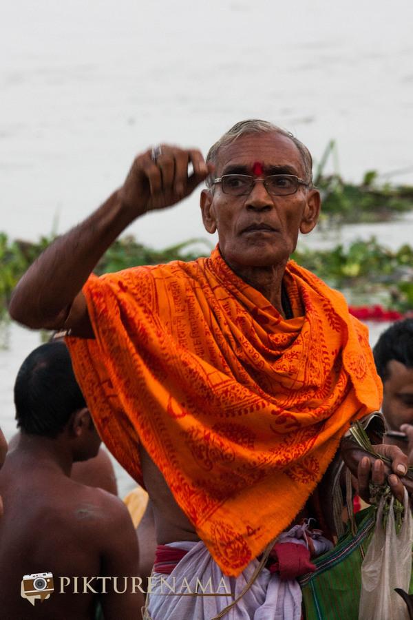 Durga Pujo the priest