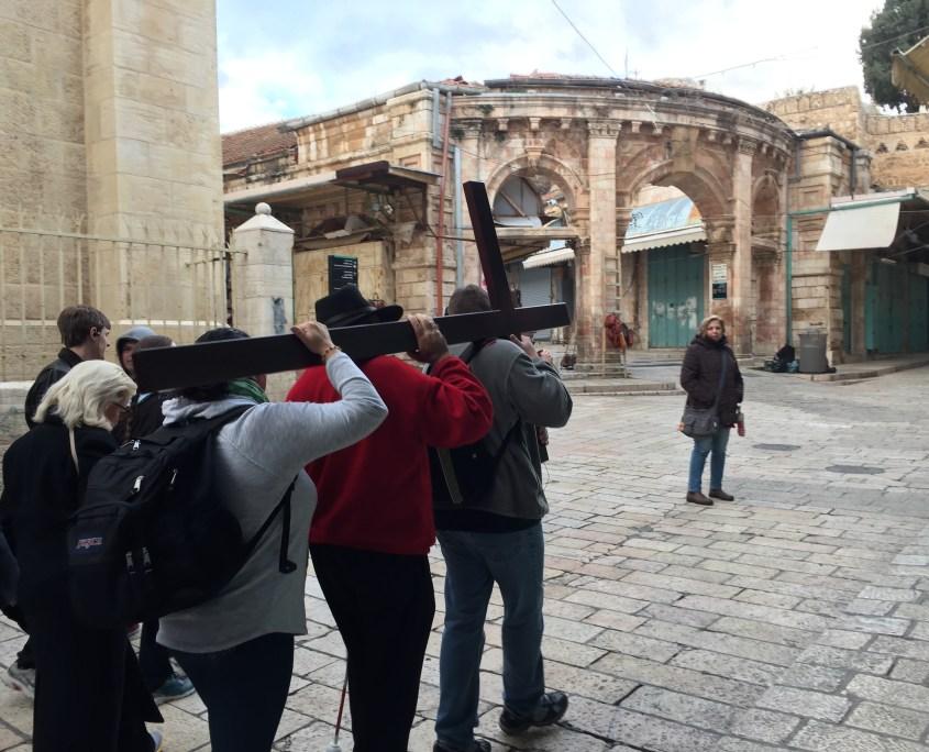 Pilgrims carry the Cross along the Via Dolorosa in Jerusalem - January 2017
