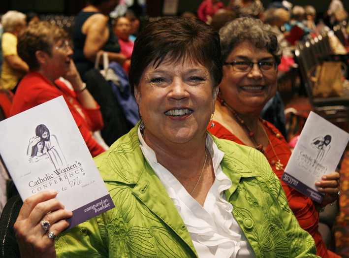 Attendees show off their Companion Booklets at the Catholic Women's Conference in San Antonio