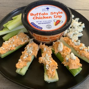 Buffalo Chicken Dip with celery keto friendly