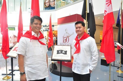 DOT Assistant Secretary Rolando Cañizal with DOT Office of Product Research & Development head Mr. Warner Andrada beside the exhibit of Flags of the Philippine Revolution