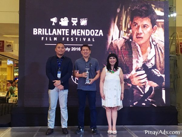 (left to right) Assistant Mall Manager Matthew Mark De Guzman, Director Brillante Ma Mendoza, and SM SVP for marketing Millie Dizon
