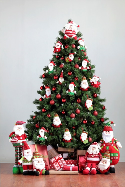 Bring Christmas to your home by decorating with oversized ornaments and Santa plushies as a topper.