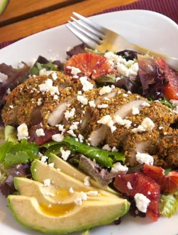 Pistachio-orange encrusted chicken salad - Pistachio-orange chicken is complemented by goat cheese, blood oranges, and avocados in this gourmet salad! | pinchmeimeating.com