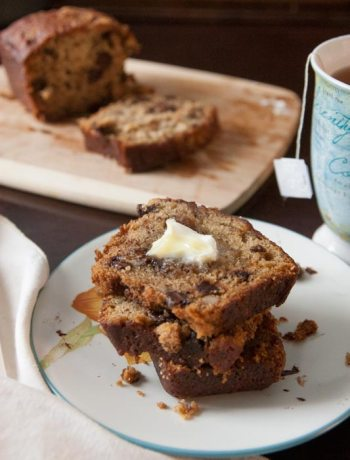 The moistest, meltiest, most delicious banana nut chocolate chip bread you'll ever taste. Quick and easy to make, it's great for breakfast AND dessert! | www.pinchmeimeating.com