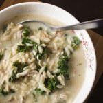 Avgolemono Soup with Kale - This hearty Greek lemon chicken soup is chock full of orzo, shredded chicken, and kale and comes together in half an hour. Added eggs make the soup rich and creamy. So delicious, and I love how quick and easy it is! | www.pinchmeimeating.com