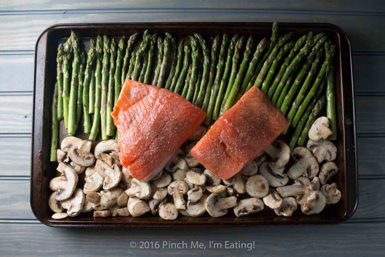 One-pan salmon with asparagus, mushrooms, and balsamic brown butter sauce is the easiest, most delicious dinner - and it's ready in only 20 minutes! This is my new favorite meal! | www.pinchmeimeating.com