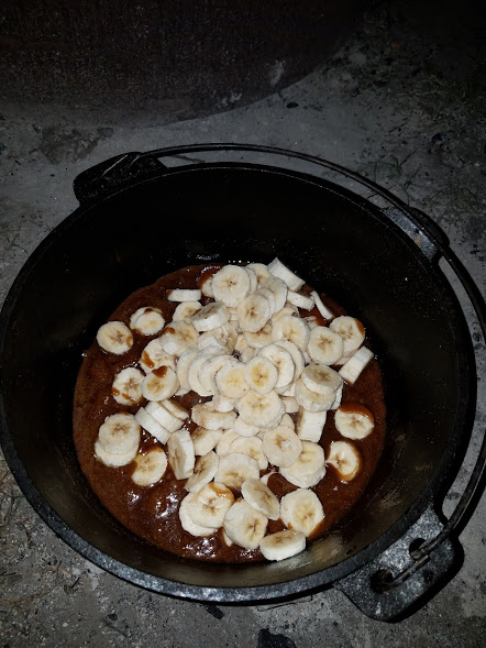 sliced bananas added to the caramel sauce in the dutch oven