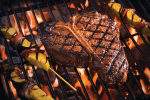 porterhouse steak on a grill with vegetable kabobs demonstrating perfect crosshatching grill marks