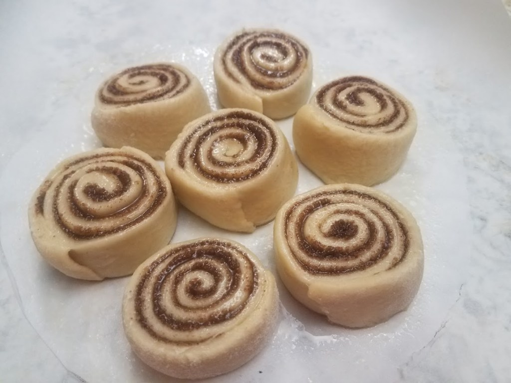 cinnamon rolls on parchment paper