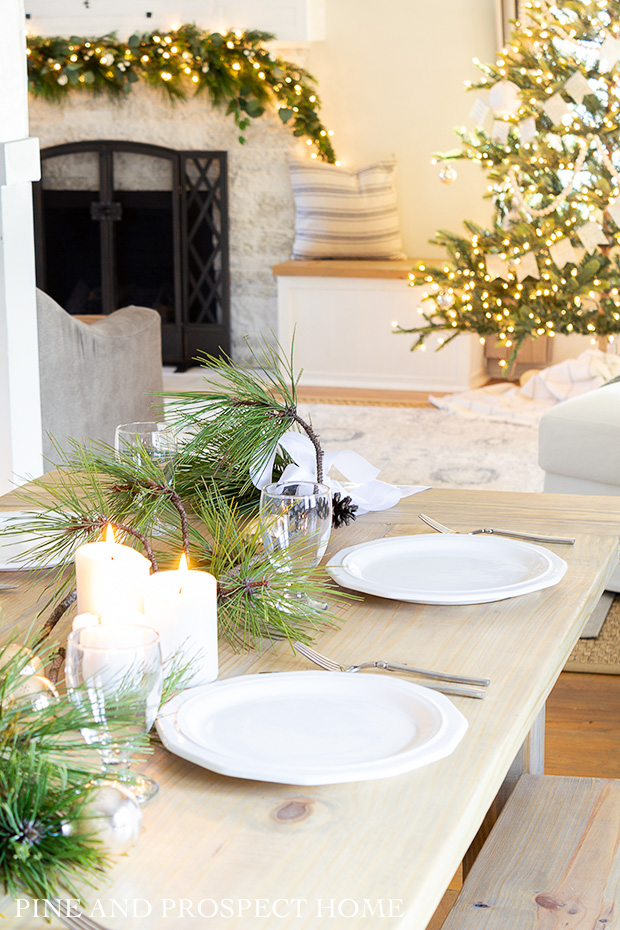 This simple ribbon and pine clippings Christmas table was so easy to put together!