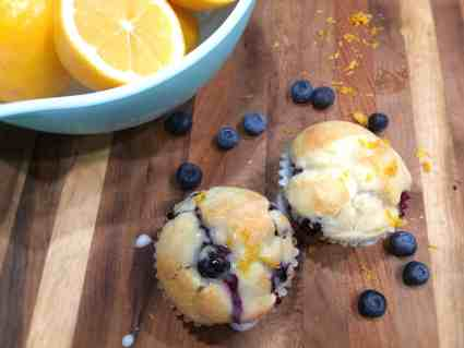 Lemon Blueberry Muffins with lemons in bowl and blueberries on board