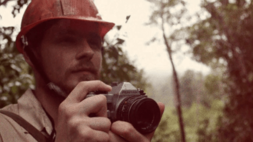One of Tim Darrow's fellow scientists taking photos in the forest of the island of Flores.