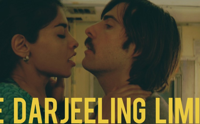 "Image from the scene where Jack (Jason Schwartzman) fingers Rita (Amara Karan) in the bathroom of the train with text ""The Darjeeling Limited""."