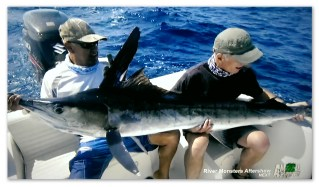 Image of Jeremy Wade with a striped marlin
