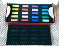 The first set of 20 half stick soft pastels, they come in little removable foam trays.