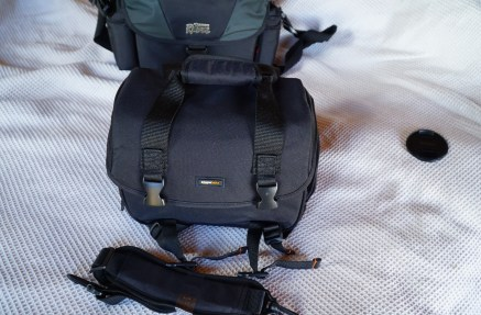 Yes this tiny bag DOES need two buckles. Because I've always wanted to waste time unbuckling two buckles to get to my single camera in my tiny bag.
