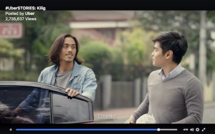 A screenshot from the Uber advert with two men talking to each other