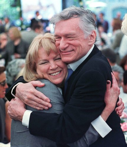 375619 01: Playboy Magazine founder Hugh Hefner and Ellen Stratton, who in 1960 became the magazine's first-ever Playmate of the Year, share a hug at the party announcing Playmate of the Year for 1999, Heather Kozar, at the Playboy Mansion, April 29, 1999 in Hollywood, California. (Photo by David McNew