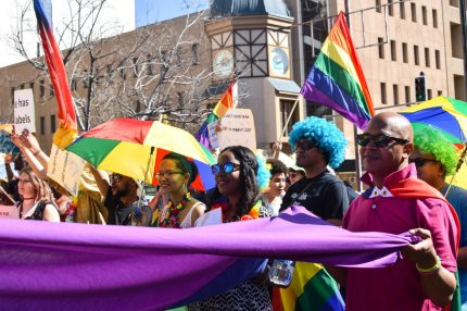 Dozens of people cheer and dance as they take part in the Namibian Lesbians, Gay, Bisexual and Transexual (LGBT) community pride Parade in the streets of the Namibian Capitol on July 29, 2017 in Windhoek.  Even though there have been marches and protests against discrimination against the LGBT community in the past years, this is the first time that the community held such a parade along the capital's main street, Independence Avenue, to celebrate their identity and rights. / AFP PHOTO / Hildegard Titus        (Photo credit should read HILDEGARD TITUS/AFP/Getty Images)