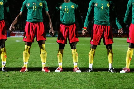 PARIS - FEBRUARY 9: Cameroon players holds hands prior to the International friendly match between Cameron and Senegal at Stade Dominique Duvauchelle on February 8, 2005 in Paris, France. (Photo by Clive Rose/Getty Images)