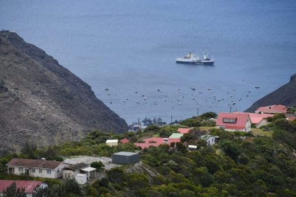 """JAMESTOWN, SAINT HELENA - OCTOBER 27:  The RMS """"St Helena"""" sails in the harbour on October 26, 2017 in Jamestown, Saint Helena. Following the introduction of weekly flights to the island, resident St Helenians, known locally as """"Saints"""", are preparing for a potential influx of tourists and investment as well as enjoying the possibilities brought by much faster transport links with South Africa. Previously, travel to the island involved travelling for a week by the Royal Mail Ship (RMS) """"Saint Helena"""" from Cape Town. Saint Helena is a 46 square mile island in the South Atlantic which has been under British control since 1834.  (Photo by Leon Neal/Getty Images)"""