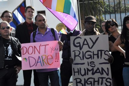"A group of people from the gay, lesbian and transgender community in South Africa demonstrate outside the Parliament in Cape Town, on May 19, 2012. The protesters gathered to oppose the proposal by the House of Traditional Leaders to remove the term ""sexual orientation"" from section 9 (3) of the South African Constitution, which prohibits unfair discrimination. AFP PHOTO / RODGER BOSCH (Photo credit should read RODGER BOSCH/AFP/GettyImages)"