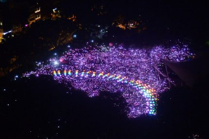 TOPSHOT - Supporters form a rainbow among lights at the annual Pink Dot event in a public show of support for the LGBT community at Hong Lim Park in Singapore on July 1, 2017. Thousands of Singaporeans took part in the gay-rights rally on July 1. / AFP PHOTO / Roslan RAHMAN (Photo credit should read ROSLAN RAHMAN/AFP/Getty Images)