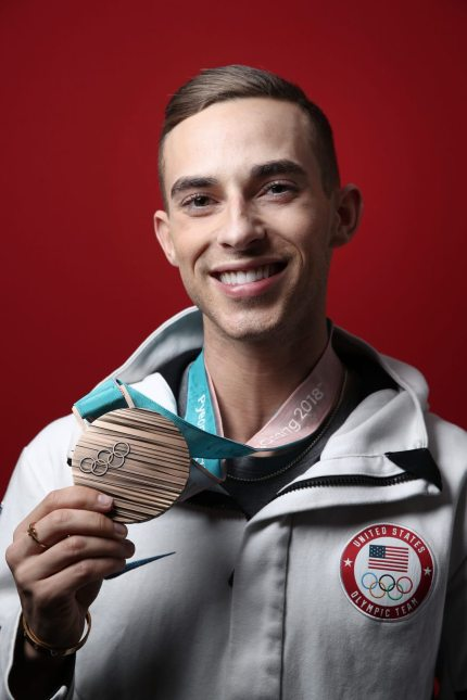 GANGNEUNG, SOUTH KOREA - FEBRUARY 17: (BROADCAST-OUT) United States Men's Figure Skater Adam Rippon poses for a portrait with his Bronze medal for the team event on the Today Show Set on February 17, 2018 in Gangneung, South Korea. (Photo by Marianna Massey/Getty Images)
