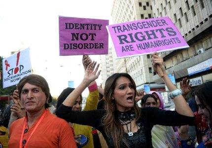 Pakistani transgender activists carry placards through Karachi (ASIF HASSAN/AFP/Getty Images)