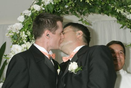 SYDNEY, NSW - NOVEMBER 25: Geoff Field (R) and Jason Kerr (L) kiss after marrying at Sydney's First Illegal Gay Wedding at Circular Quay November 25, 2005 in Sydney, Australia. (Photo by Stephane L'hostis/Getty Images)