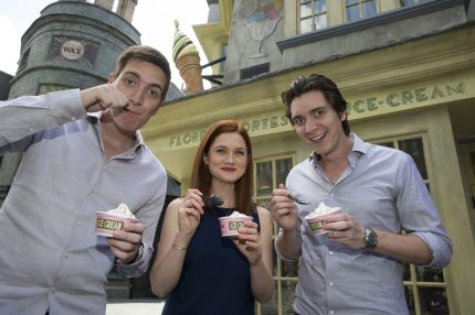 ORLANDO, FL - JUNE 05: In this handout photo provided by Universal Orlando Resort, James Phelps, Bonnie Wright and Oliver Phelps from the popular Harry Potter film series enjoyed a sneak peek of the highly anticipated, spectacularly themed environment, The Wizarding World of Harry Potter - Diagon Alley at Universal Studios Florida on June 5, 2014 in Orlando Florida. The actors who portrayed siblings Fred, George and Ginny Weasley in the films stepped inside memorable shops within Diagon Alley, including the Weasley twins' very own shop - Weasleys' Wizard Wheezes. (Photo by  Kevin Kolczynski/Universal Orlando Resort via Getty Images)