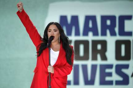 "WASHINGTON, DC - MARCH 24: Demi Lovato performs ""Skyscraper"" during the March for Our Lives rally on March 24, 2018 in Washington, DC. Hundreds of thousands of demonstrators, including students, teachers and parents gathered in Washington for the anti-gun violence rally organized by survivors of the Marjory Stoneman Douglas High School shooting on February 14 that left 17 dead. More than 800 related events are taking place around the world to call for legislative action to address school safety and gun violence. (Photo by Chip Somodevilla/Getty Images)"