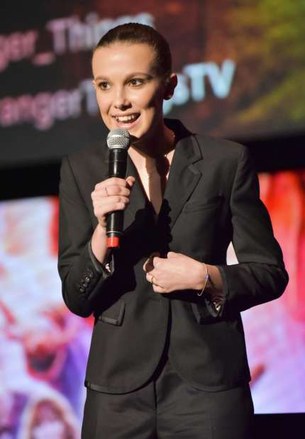 """LOS ANGELES, CA - MAY 19:  Millie Bobby Brown speaks on stage at #NETFLIXFYSEE event for """"Stranger Things"""" at Netflix FYSEE at Raleigh Studios on May 19, 2018 in Los Angeles, California.  (Photo by Rodin Eckenroth/Getty Images)"""