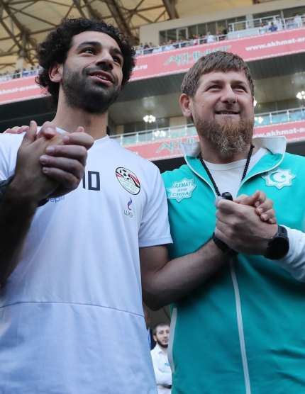 dc0deef28 Egyptian national team football player and Liverpool s star striker Mohamed  Salah (L) poses with head of the Chechen Republic Ramzan Kadyrov during a  ...