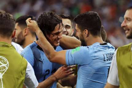 SOCHI, RUSSIA - JUNE 30:  Edinson Cavani of Uruguay celebrates with teammate Luis Suarez after scoring his team's second goal during the 2018 FIFA World Cup Russia Round of 16 match between Uruguay and Portugal at Fisht Stadium on June 30, 2018 in Sochi, Russia.  (Photo by Richard Heathcote/Getty Images)