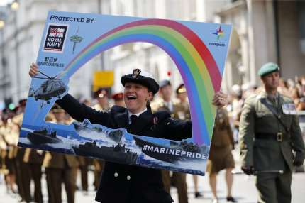 Members of the defence forces join supporters and members of the Lesbian, Gay, Bisexual and Transgender community taking part in the annual Pride Parade in London on July 7, 2018.