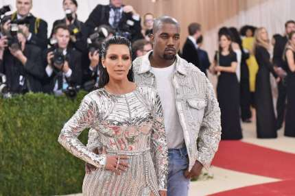 """NEW YORK, NY - MAY 02: Kim Kardashian (L) and Kanye West attend the """"Manus x Machina: Fashion In An Age Of Technology"""" Costume Institute Gala at Metropolitan Museum of Art on May 2, 2016 in New York City. (Photo by Mike Coppola/Getty Images for People.com)"""