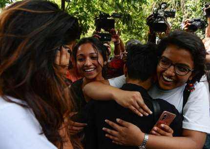 """Indian members of the lesbian, gay, bisexual, transgender (LGBT) community celebrate outside the Supreme Court after the decision to strike down the colonial-era ban on gay sex in New Delhi on September 6, 2018. - India's Supreme Court on September 6 struck down the ban that has been at the centre of years of legal battles. """"The law had become a weapon for harassment for the LGBT community,"""" Chief Justice Dipak Misra said as he announced the landmark verdict. (Photo by Sajjad HUSSAIN / AFP) (Photo credit should read SAJJAD HUSSAIN/AFP/Getty Images)"""