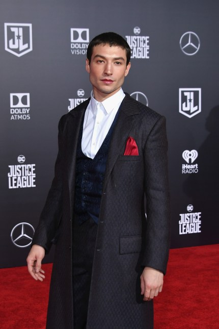 Fantastic Beasts' Ezra Miller wearing a suit at the premiere of Justice League