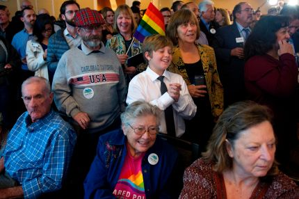 Supporters of US Representative Jared Polis (D) celebrate his campaign victory